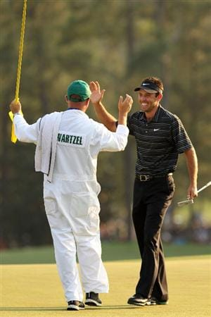 AUGUSTA, GA - APRIL 10:  Charl Schwartzel of South Africa celebrates his two-stroke victory with his caddie Greg Hearmon on the 18th green during the final round of the 2011 Masters Tournament at Augusta National Golf Club on April 10, 2011 in Augusta, Georgia.  (Photo by Andrew Redington/Getty Images)