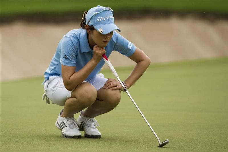 CHON BURI, THAILAND - FEBRUARY 20:  Shinobu Moromizato of Japan lines up a putt on the 8th green during round three of the Honda PTT LPGA Thailand at Siam Country Club on February 20, 2010 in Chon Buri, Thailand.  (Photo by Victor Fraile/Getty Images)