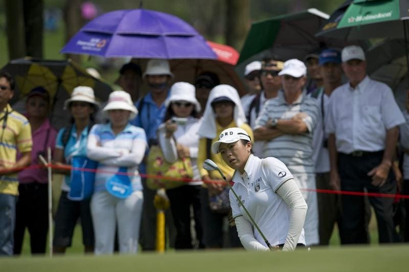 CHON BURI, THAILAND - FEBRUARY 19:  Hur M.J. of South Korea chips onto the 10th green during round two of the Honda LPGA Thailand at the Siam Country Club on February 19, 2010 in Chon Buri, Thailand.  (Photo by Victor Fraile/Getty Images)