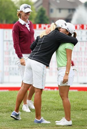 SPRINGFIELD, IL - JUNE 07:  In-Kyung Kim (R) of South Korea hugs Suzann Pettersen of Norway (C) and Helen Alfredsson of Sweden (L) after Kim finished her fourth round of the LPGA State Farm Classic golf tournament at Panther Creek Country Club on June 7, 2009 in Springfield, Illinois.  (Photo by Christian Petersen/Getty Images)