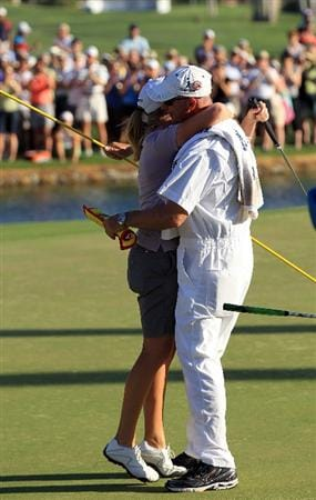 RANCHO MIRAGE, CA - APRIL 03:  Stacy Lewis of the USA embraces her caddie Travis Wilson on the 18th green during the final round of the 2011 Kraft Nabisco Championship on the Dinah Shore Championship Course at the Mission Hills Country Club on April 3, 2011 in Rancho Mirage, California.  (Photo by David Cannon/Getty Images)