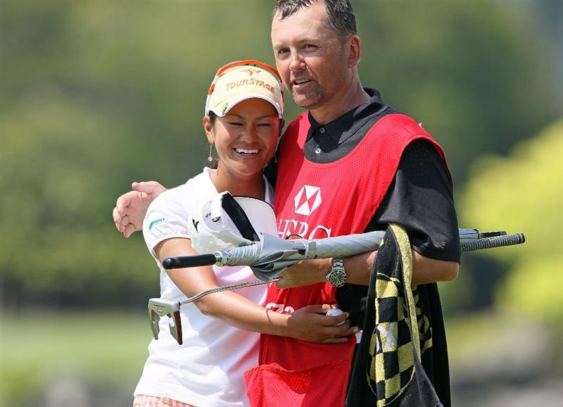 SINGAPORE - FEBRUARY 28:  Ai Miyazato of Japan hugs her caddie Mike Seaborn (R) after winning the HSBC Women's Champions at Tanah Merah Country Club on February 28, 2010 in Singapore, Singapore.  (Photo by Andy Lyons/Getty Images)
