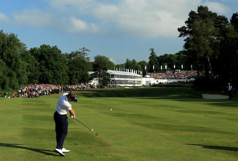 VIRGINIA WATER, ENGLAND - MAY 29:  (EDITORS NOTE: A POLARIZING FILTER WAS USED IN THE CAPTURE OF THIS IMAGE) Luke Donald of England  hits his 2nd shot on the 18th hole in a playoff during the final round of the BMW PGA Championship  at the Wentworth Club on May 29, 2011 in Virginia Water, England.  (Photo by David Cannon/Getty Images)