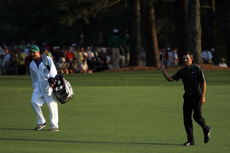 AUGUSTA, GA - APRIL 10:  Charl Schwartzel of South Africa walks with his caddie Greg Hearmon to the 18th green during the final round of the 2011 Masters Tournament at Augusta National Golf Club on April 10, 2011 in Augusta, Georgia.  (Photo by Jamie Squire/Getty Images)