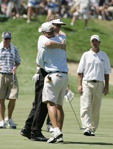 John Senden hugs his caddie as he wins the John Deere Classic at TPC Deere Run in Silvis, Illinois on July 16, 2006.Photo by Michael Cohen/WireImage.com
