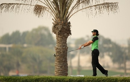 DOHA, QATAR - JANUARY 26: Johan Edfors of Sweden tees off on the par four 11th hole during the third round of the Commercialbank Qatar Masters held at the Doha Golf Club on January 26, 2008 in Doha,Qatar.  (Photo by Ross Kinnaird/Getty Images)