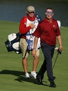 Woody Austin (R) of the U.S. Team walks to the 14th green wearing a dive mask alongside his caddie Brent Henley during the final day singles matches at The Presidents Cup at The Royal Montreal Golf Club on September 30, 2007 in Montreal, Quebec, Canada. PGA TOUR - 2007 The Presidents Cup - Final RoundPhoto by Scott Halleran/WireImage.com