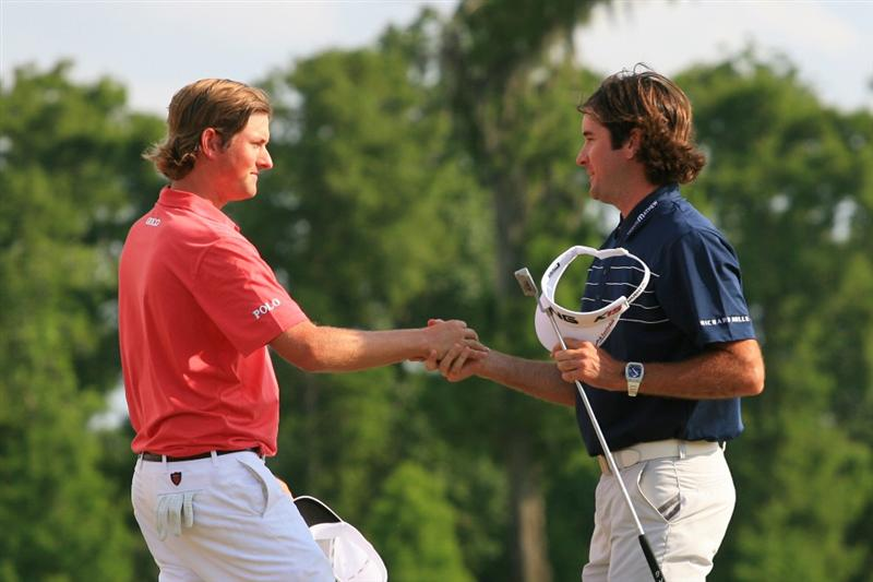 NEW ORLEANS, LA - MAY 1: Bubba Watson and Webb Simpson shake hands on the 18th green after finishing in a tie for first place during the final round of the Zurich Classic at the TPC Louisiana on May 1, 2011 in New Orleans, Louisiana. (Photo by Hunter Martin/Getty Images)
