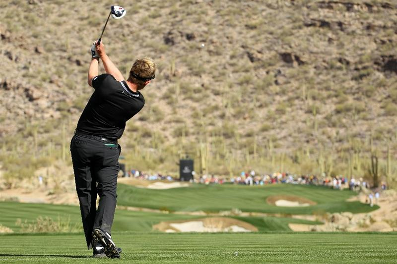 MARANA, AZ - FEBRUARY 25:  Luke Donald of England hits his tee shot on the 15th hole during the third round of the Accenture Match Play Championship at the Ritz-Carlton Golf Club on February 25, 2011 in Marana, Arizona.  (Photo by Andy Lyons/Getty Images)