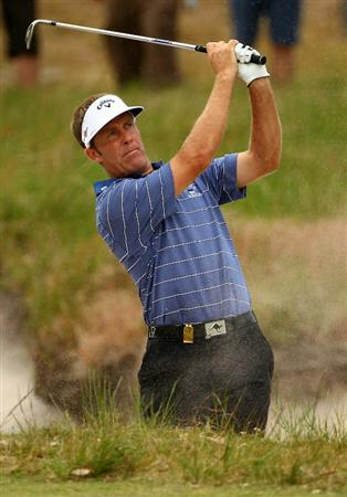 MELBOURNE, AUSTRALIA - NOVEMBER 12:  Stuart Appleby of Australia hits his shot out of the bunker during round two of the Australian Masters at The Victoria Golf Club on November 12, 2010 in Melbourne, Australia.  (Photo by Robert Cianflone/Getty Images)