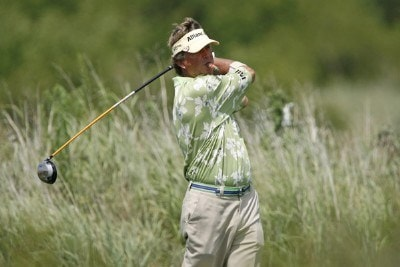 Dana Quigley hits a drive while smoking on a cigar during the third round of the U.S. Senior Open at Prairie Dunes Country Club in Hutchinson,  Kansas on July 8, 2006.Photo by G. Newman Lowrance/WireImage.com