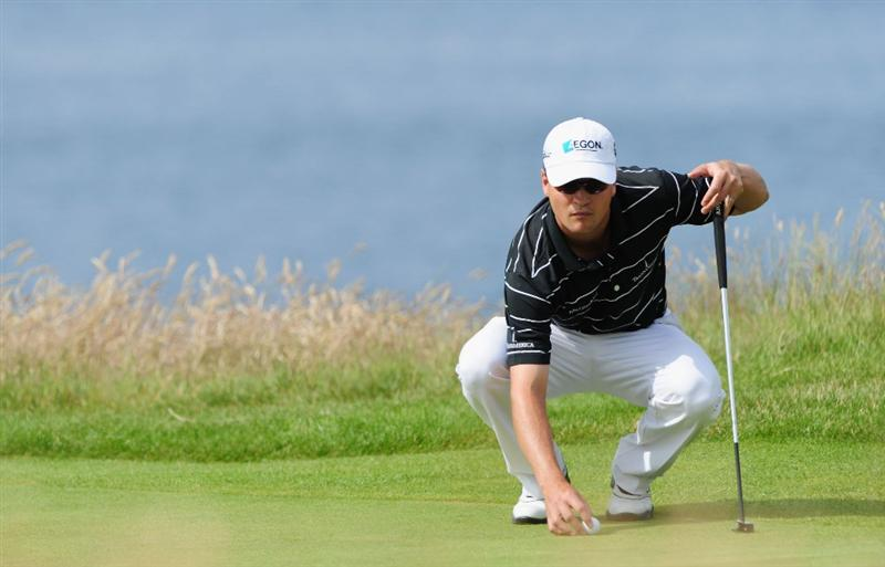 TURNBERRY, SCOTLAND - JULY 16:   Zach Johnson of USA lines up a putt on the 11th green during round one of the 138th Open Championship on the Ailsa Course, Turnberry Golf Club on July 16, 2009 in Turnberry, Scotland.  (Photo by Stuart Franklin/Getty Images)