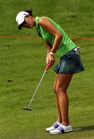 KUALA LUMPUR, MALAYSIA - OCTOBER 21:  Michelle Wie of USA watches her putting on the 8th hole during the Sime Darby Pro-Am at the KLGCC Golf Course on October 21, 2010 in Kuala Lumpur, Malaysia.  (Photo by Stanley Chou/Getty Images)