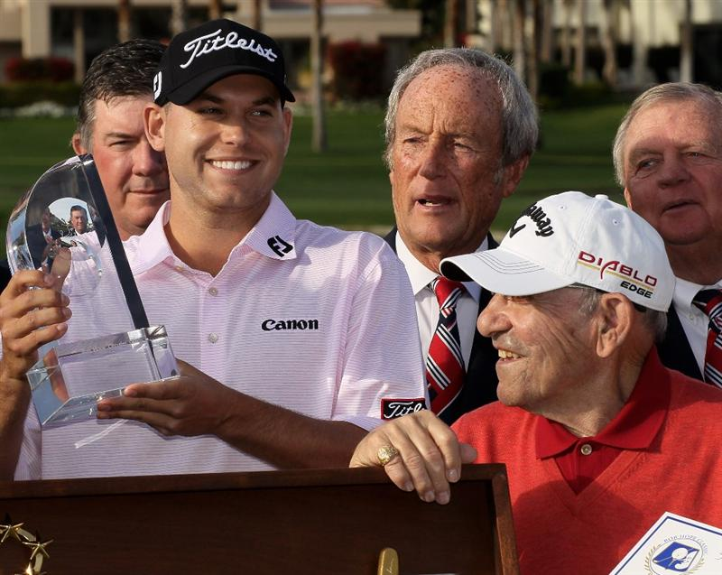 LA QUINTA, CA - JANUARY 25:  Bill Haas holds the trophjy next to tournament ambassador and baseball Hall of Famer Yogi Berra during ceremonies at the Palmer Private course at PGA West after winning the Bob Hope Classic on January 25, 2010 in La Quinta, California.  (Photo by Stephen Dunn/Getty Images)