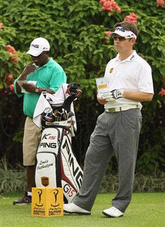 KUALA LUMPUR, MALAYSIA - APRIL 13:  Louis Oosthuizen of South Africa looks on alongside his caddie Zacharia Rasego during a practice round ahead of the Maybank Malaysian Open at Kuala Lumpur Golf & Country Club on April 13, 2011 in Kuala Lumpur, Malaysia.  (Photo by Ian Walton/Getty Images)