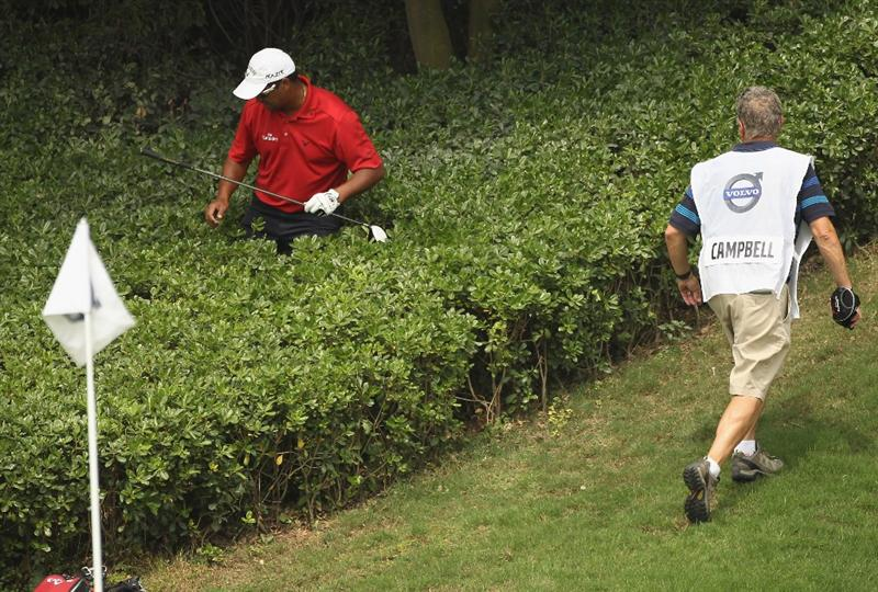 CHENGDU, CHINA - APRIL 22:  Michael Campbell of New Zealand looks for his ball on the 10th hole during day two of the Volvo China Open at Luxehills Country Club on April 22, 2011 in Chengdu, China.  (Photo by Ian Walton/Getty Images)