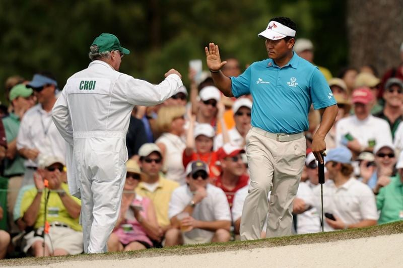 AUGUSTA, GA - APRIL 09:  K.J. Choi of South Korea reacts to saving par on the seventh hole with his caddie Andy Prodger during the third round of the 2011 Masters Tournament at Augusta National Golf Club on April 9, 2011 in Augusta, Georgia.  (Photo by Harry How/Getty Images)