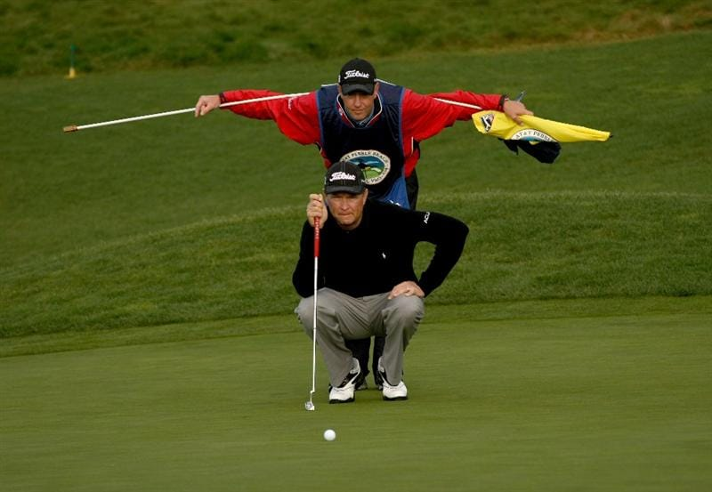 PEBBLE BEACH, CA - FEBRUARY 12:  Davis Love III  and his caddy line up his putt on the first hole during the first round of the AT&T Pebble Beach National Pro-Am at Pebble Beach Golf Links on February 12, 2009 in Pebble Beach, California.  (Photo by Stephen Dunn/Getty Images)