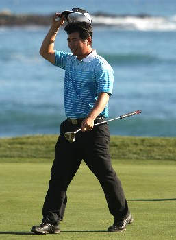 PEBBLE BEACH, CA - FEBRUARY 9: Y.E. Yang of South Korea acknowledges the crowd on the 18th hole during the third round of the AT&T Pebble Beach National Pro-Am at Pebble Beach Golf Links February 9, 2008 in Pebble Beach, California.  (Photo by Jed Jacobsohn/Getty Images)