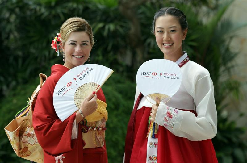 SINGAPORE - FEBRUARY 22:  Paula Creamer of the USA and Michelle Wie of the USA in traditional Japanese and Korean dress during a photocall at the Fairmont Hotel prior to the HSBC Women's Champions at Tanah Merah Country Club  on February 22, 2011 in Singapore, Singapore.  (Photo by Ross Kinnaird/Getty Images)