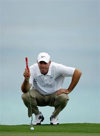 SOUTHAMPTON, BERMUDA - OCTOBER 21:  Stewart Cink the 2009 Brittish Open champion, lines up his birdie putt on the 9th hole during the final round of the PGA Grand Slam of Golf on October 21, 2009 at Port Royal Golf Course in Southampton, Bermuda.  (Photo by Andy Lyons/Getty Images)