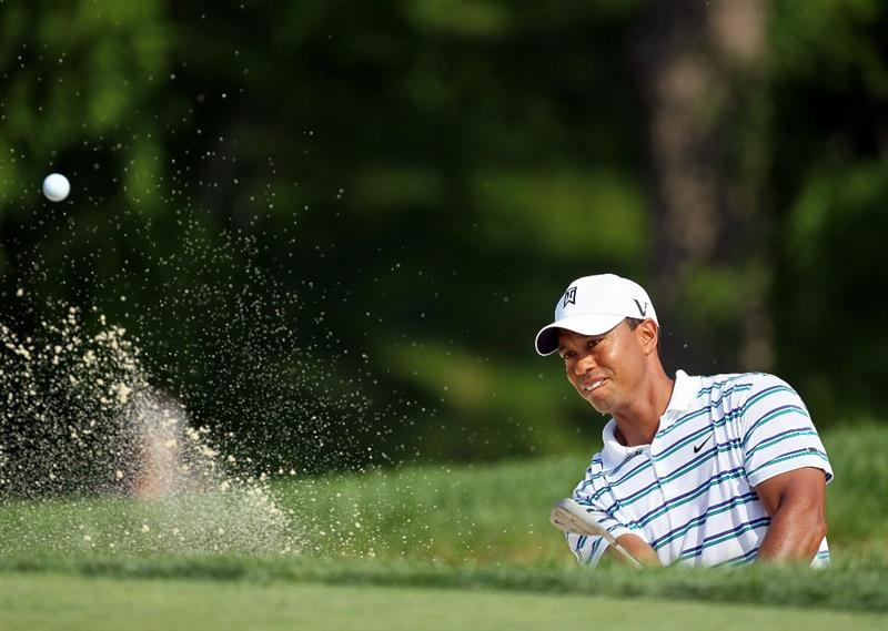 DUBLIN, OH - JUNE 04:  Tiger Woods hits his third shot on the 18th hole during the second round of The Memorial Tournament presented by Morgan Stanley at Muirfield Village Golf Club on June 4, 2010 in Dublin, Ohio.  (Photo by Andy Lyons/Getty Images)
