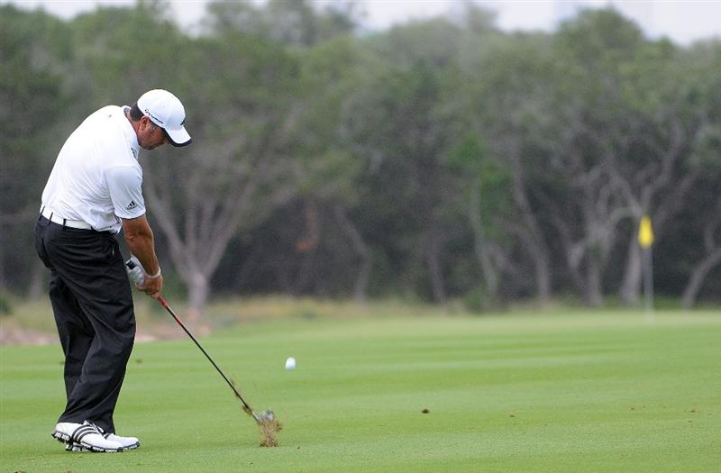 SAN ANTONIO, TX- MAY 13: Pat Perez hits his approach shot to the 1st green  during the first round of the Valero Texas Open at the TPC San Antonio on May 13, 2010 in San Antonio, Texas. (Photo by Marc Feldman/Getty Images)
