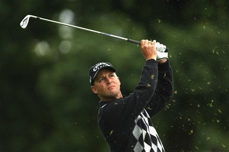 LUSS, UNITED KINGDOM - JULY 10:  Niclas Fasth of Sweden hits an approach shot during the First Round of The Barclays Scottish Open at Loch Lomond Golf Club on July 10, 2008 in Luss, Scotland. (Photo by Warren Little/Getty Images)