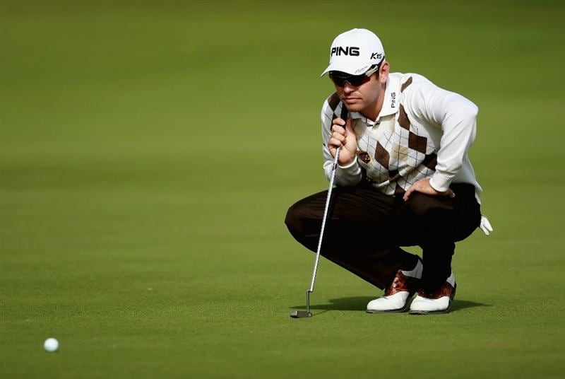 DOHA, QATAR - FEBRUARY 03:  Louis Oosthuizen of South Africa lines up a putt on the 17th hole during the first round of the Commercialbank Qatar Masters held at Doha Golf Club on February 3, 2011 in Doha, Qatar.  (Photo by Andrew Redington/Getty Images)