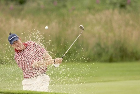 Greg Owen blasts out of a bunker during the third round of the 2005 Barclays Scottish Open at the Loch Lomond Golf Club in Glasgow, Scotland on July 9, 2005.Photo by Pete Fontaine/WireImage.com