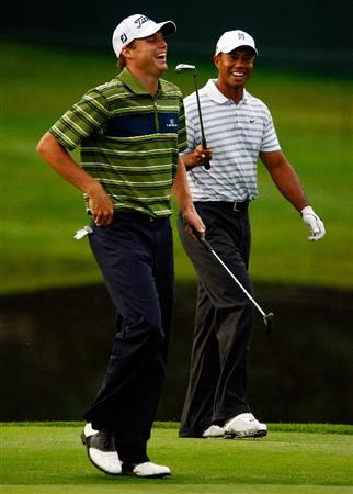 CHASKA, MN - AUGUST 10:  Tiger Woods (R) walks with Nick Watney during a practice round prior to the start of the 91st PGA Championship at the Hazeltine Golf Club on August 10, 2009 in Chaska, Minnesota.  (Photo by Scott Halleran/Getty Images)