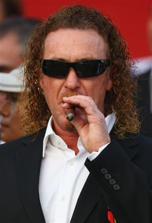 SHENZHEN, CHINA - NOVEMBER 26:  Miguel Angel Jimenez of Spain lights a cigar after the opening ceremony of the Omega Mission Hills World Cup at the Mission Hills Resort on November 26, 2008 in Shenzhen, China.  (Photo by Ian Walton/Getty Images)