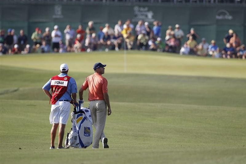 HUMBLE, TX - APRIL 01: Matt Kuchar (R) prepares to play his second shot on the 18th hole during the second round of the Shell Houston Open at Redstone Golf Club on April 1, 2011 in Humble, Texas.  (Photo by Michael Cohen/Getty Images)