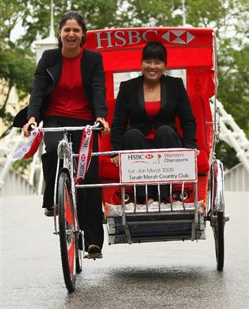 SINGAPORE - MARCH 03:  Lorena Ochoa of Mexico (left) drives Inbee Park of Korea on a trishaw during a photocall and press conference in downtown Singapore prior to the start of the HSBC Women's Champions at Tanah Merah Country Club on March 3, 2009 in Singapore.  (Photo by Andrew Redington/Getty Images)