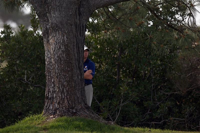 LA JOLLA, CA - FEBRUARY 08: John Rollins looks on from behind a tree in the rough of the 17th hole during the Final Round of the Buick Invitational at the Torrey Pines North Course on February 8, 2009 in La Jolla, California. (Photo by Donald Miralle/Getty Images)