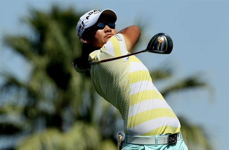 RANCHO MIRAGE, CA - APRIL 04:  Yani Tseng of Taiwan hits her tee shot on the 11th hole during the final round of the Kraft Nabisco Championship at Mission Hills Country Club on April 4, 2010 in Rancho Mirage, California.  (Photo by Stephen Dunn/Getty Images)