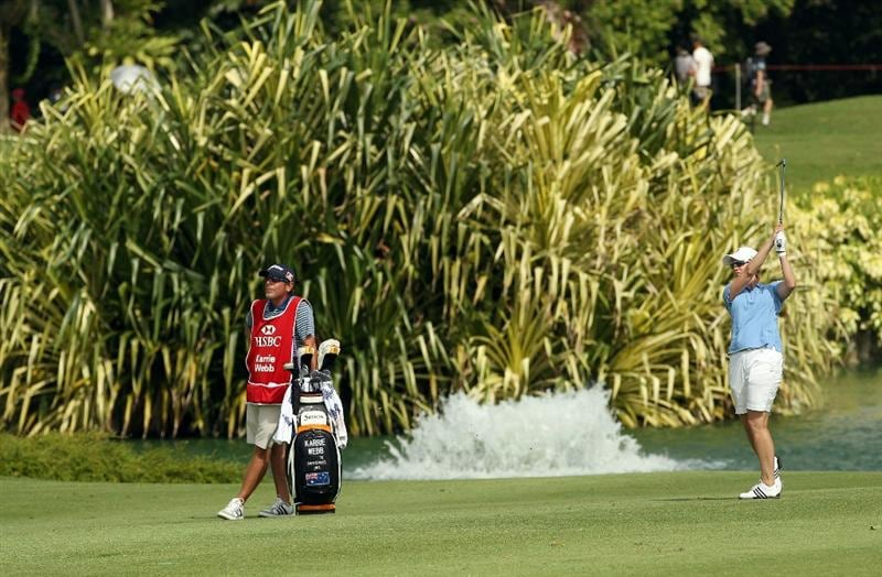 SINGAPORE - FEBRUARY 27:  Karrie Webb of Australia watches her shot during the final round of the HSBC Women's Champions at the Tanah Merah Country Club on February 27, 2011 in Singapore.  (Photo by Andrew Redington/Getty Images)