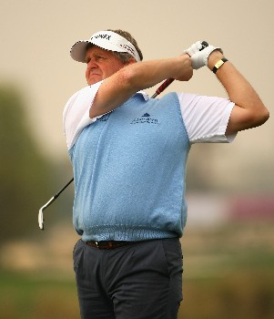 DOHA, QATAR - JANUARY 26:  Colin Montgomerie of Scotland hits his third shot on the ninth hole during the third round of the Commercialbank Qatar Masters at Doha Golf Club on January 26, 2008 in Doha, Qatar.  (Photo by Andrew Redington/Getty Images)
