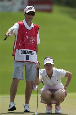 CHON BURI, THAILAND - FEBRUARY 20:  Paula Creamer of USA and caddie line up a putt on the 4th hole during day four of the LPGA Thailand at Siam Country Club on February 20, 2011 in Chon Buri, Thailand.  (Photo by Victor Fraile/Getty Images)
