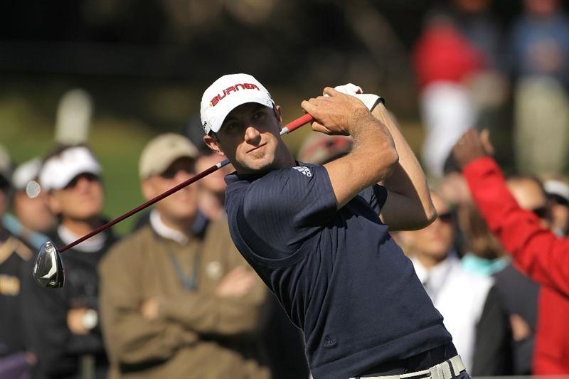 PEBBLE BEACH, CA - FEBRUARY 14:  Dustin Johnson tees off on the fourth hole during the final round of the AT&T Pebble Beach National Pro-Am Pebble Beach Golf Links on February 14, 2010 in Pebble Beach, California.  (Photo by Ezra Shaw/Getty Images)