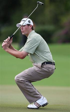 WEST PALM BEACH, FL - DECEMBER 07:  Chris Wilson reacts after nearly sinking a birdie putt on the 1st hole during the final round of the 2009 PGA TOUR Qualifying Tournament at Bear Lakes Country Club on December 7, 2009 in West Palm Beach, Florida.  (Photo by Doug Benc/Getty Images)