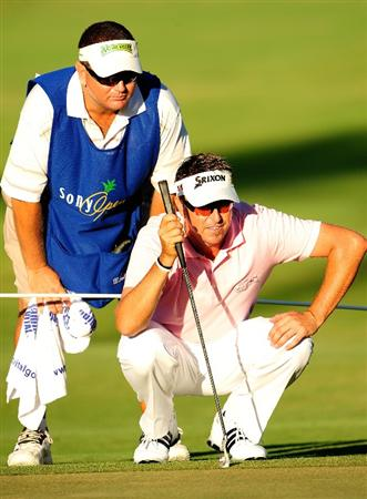 HONOLULU - JANUARY 17:  Robert Allenby of Australia looks over a putt on the 18th hole during the final round of the Sony Open at Waialae Country Club on January 17, 2010 in Honolulu, Hawaii.  (Photo by Sam Greenwood/Getty Images)