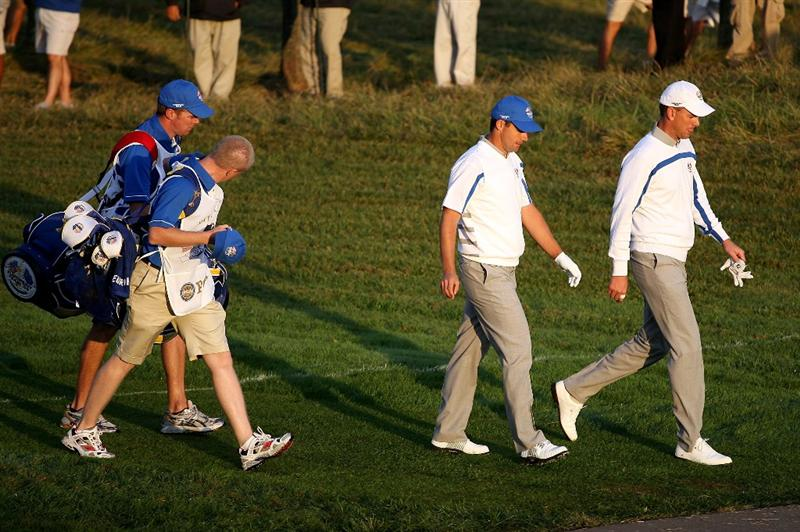 LOUISVILLE, KY - SEPTEMBER 19:  Padraig Harrington and Robert Karlsson of the European team walk off the first tee with their caddies during the morning foursomes on day one of the 2008 Ryder Cup at Valhalla Golf Club on September 19, 2008 in Louisville, Kentucky.  (Photo by Andy Lyons/Getty Images)