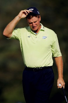 MALELANE, SOUTH AFRICA - DECEMBER 09:  Ernie Els of South Africa walks off the 18th green after taking an eight on the 18th hole to lose the The Alfred Dunhill Championship at The Leopard Creek Country Club on December 9, 2007 in Malelane, South Africa.  (Photo by Warren Little/Getty Images)