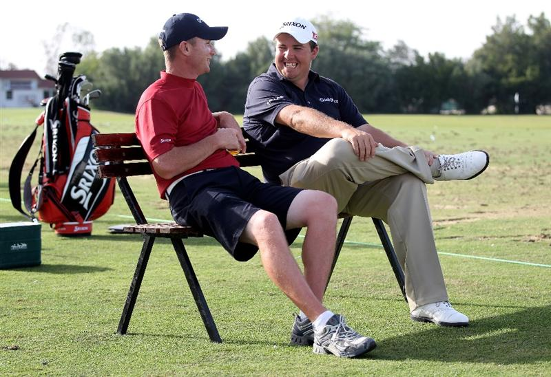 DOHA, QATAR - JANUARY 29:  Shane Lowry of Ireland and his caddie Dermot Byrne on the driving range the second round of the Commercialbank Qatar Masters at the Doha Golf Club on January 29, 2010 in Doha, Qatar.  (Photo by Ross Kinnaird/Getty Images)