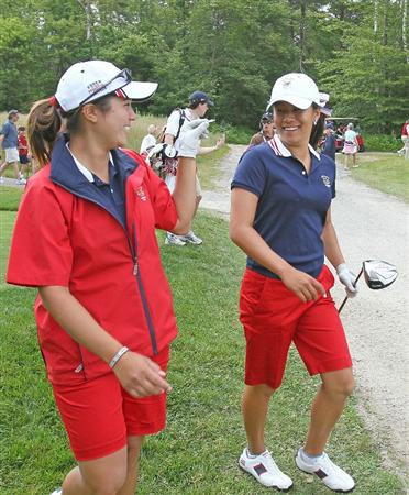 MANCHESTER, MA - JUNE 12:  Stephanie Kono (L) and Kimberly Kim of the United States walk toward the third fairway in Four Ball competition during the second day of the 2010 Curtis Cup Match at the Essex Country Club on June 12, 2010 in Manchester, Massachusetts. (Photo by Jim Rogash/Getty Images)