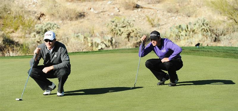 MARANA, AZ - FEBRUARY 24:  Justin Rose of England and Martin Kaymer of Germany line up their putts on the 18th hole during the second round of the Accenture Match Play Championship at the Ritz-Carlton Golf Club on February 24, 2011 in Marana, Arizona.  (Photo by Stuart Franklin/Getty Images)