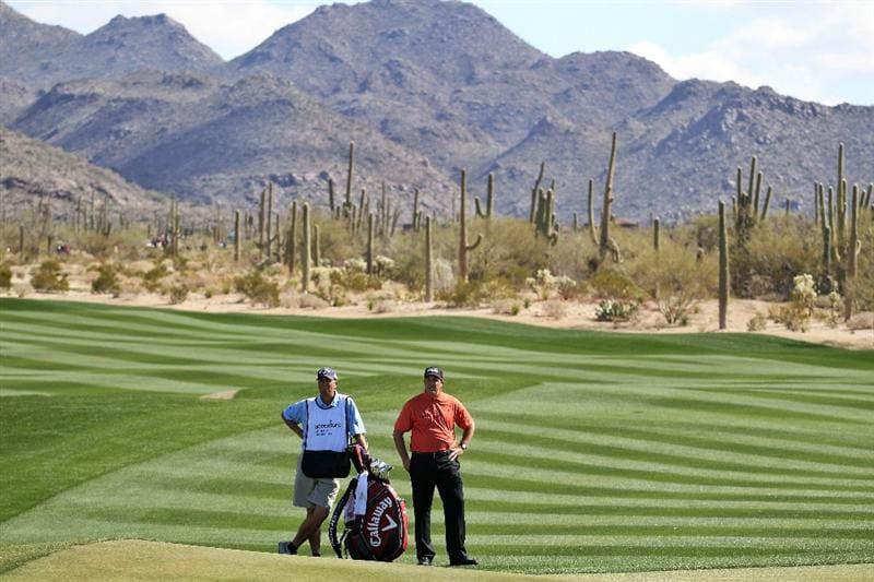 MARANA, AZ - FEBRUARY 24:  Phil Mickelson and caddie Jim 'Bones' Mackay (L) look on from the second hole during the second round of the Accenture Match Play Championship at the Ritz-Carlton Golf Club on February 24, 2011 in Marana, Arizona.  (Photo by Andy Lyons/Getty Images)