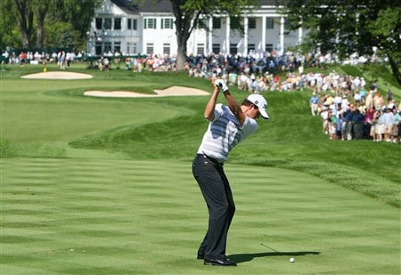 BLOOMFIELD HILLS, MI - AUGUST 06: Adam Scott of Australia hits a shot in front of the clubhouse and a gallery during a practice round prior to the 90th PGA Championship at Oakland Hills Country Club on August 6, 2008 in Bloomfield Township, Michigan.  (Photo by Stuart Franklin/Getty Images)