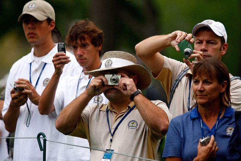 CHASKA, MN - AUGUST 10:  Golf fans photograph Tiger Woods during a practice round prior to the start of the 91st PGA Championship at the Hazeltine Golf Club on August 10, 2009 in Chaska, Minnesota.  (Photo by Scott Halleran/Getty Images)